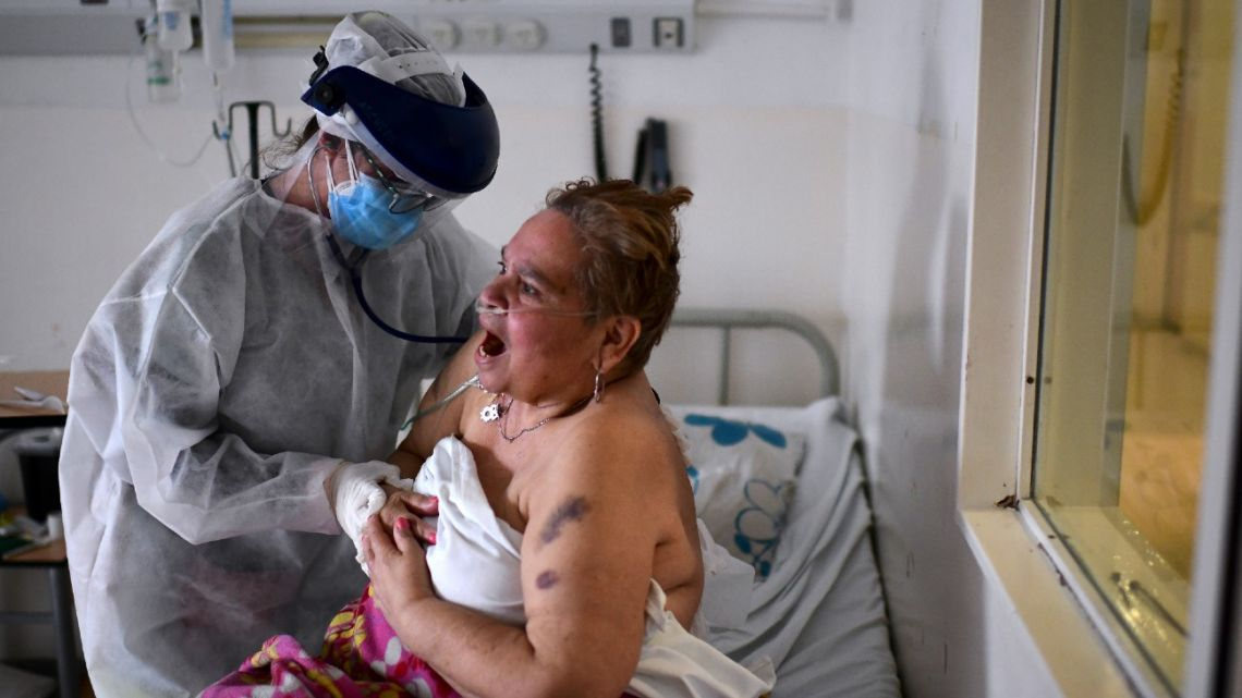 A patient infected with the new coronavirus is treated by a doctor at the Doctor Alberto Antranik Eurnekian Public Hospital in Ezeiza.