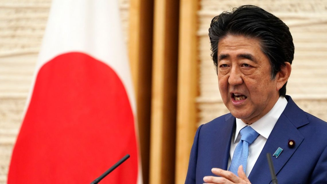 In this May 4, 2020, file photo, Japan's Prime Minister Shinzo Abe speaks during a press conference at his official residence in Tokyo.