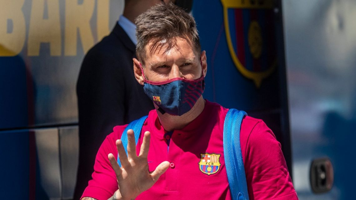 In this August 13, 2020 file photo, Barcelona's Lionel Messi waves as he arrives at the the team's hotel in Lisbon, Portugal.