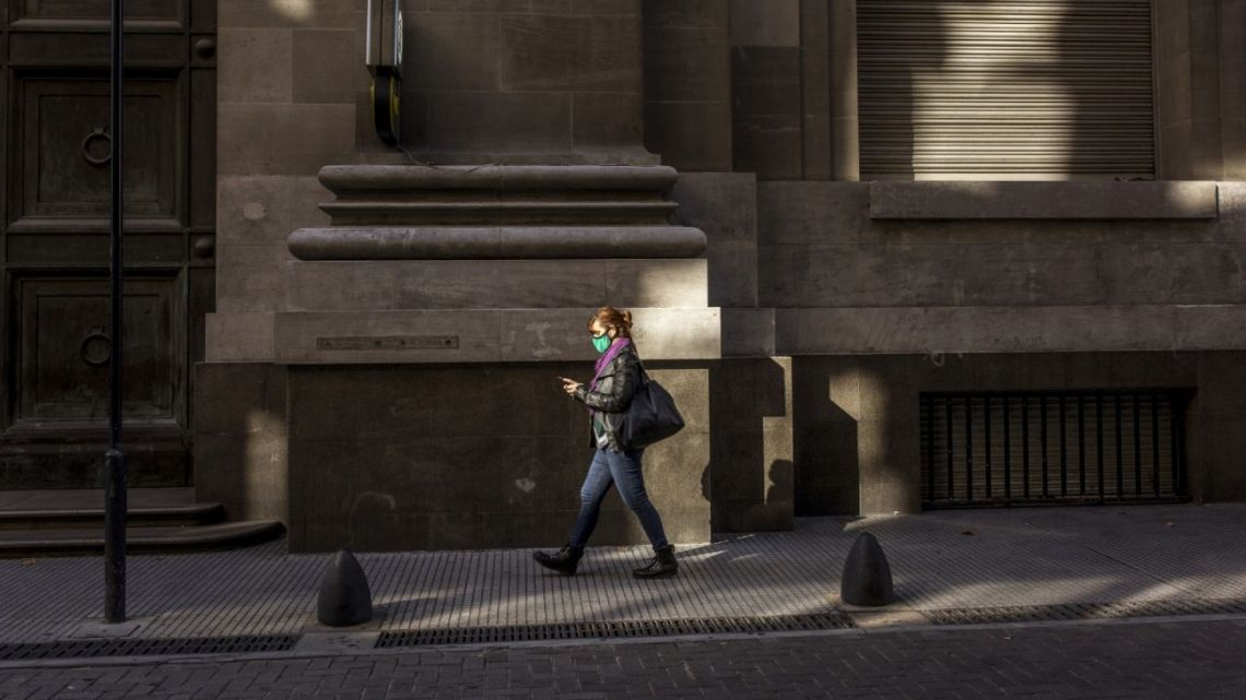 A porteño walks through the financial district of Buenos Aires during the coronavirus pandemic.