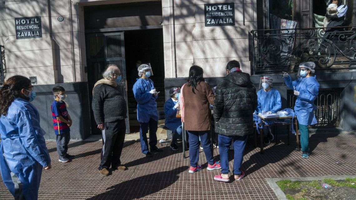 Healthcare workers from the University of Buenos Aires wearing personal protective equipment (PPE) prepare to conduct Covid-19 tests in San Telmo.