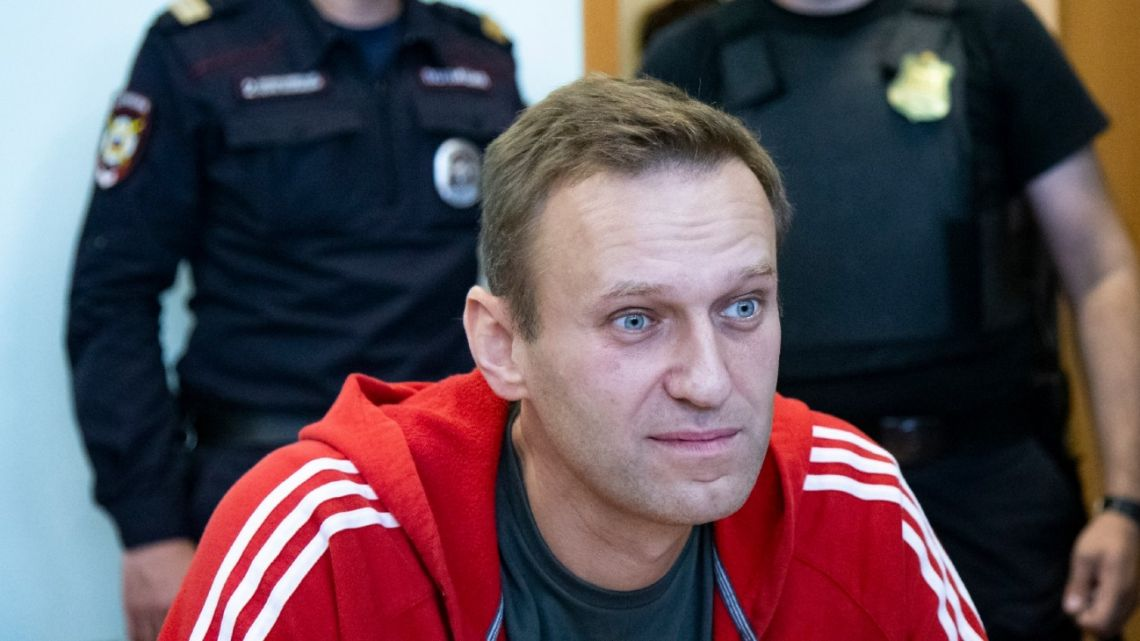 In this photo taken on Thursday, August 22, 2019, Russian opposition leader Alexei Navalny speaks to the media prior to a court session in Moscow, Russia.