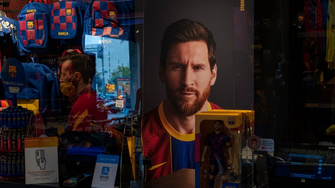 A poster with the face of Lionel Messi is displayed at a Barcelona store on Tuesday, September 1, 2020.