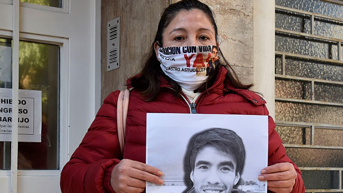 Cristina Castro, the mother of Facundo Astudillo Castro, holding a sign showing her late son.