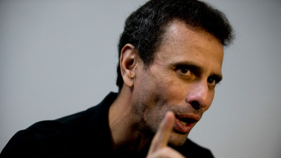 In this July 30, 2018 file photo, Venezuelan opposition leader Henrique Capriles speaks during an interview at his office in Caracas, Venezuela.