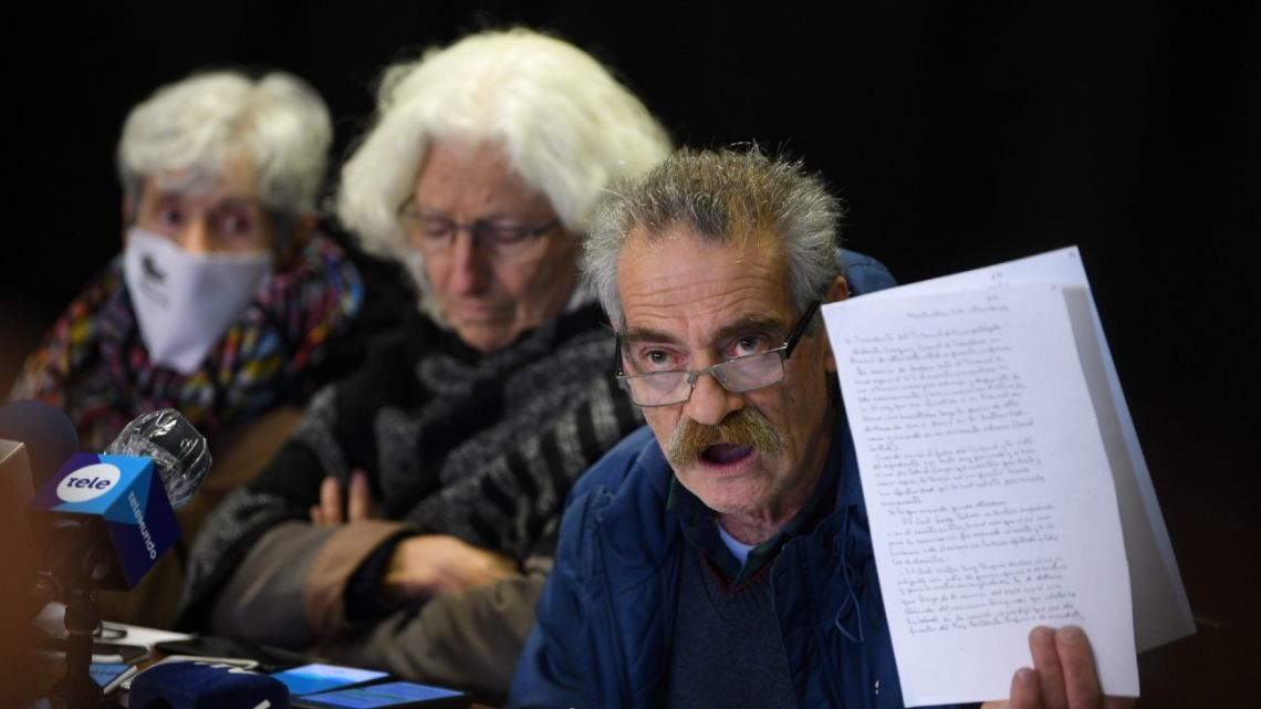 Ignacio Errandonea, member of the Madres y Familiares de Detenidos Desaparecidos en Uruguay, holds part of a copy of an Army's honor court document about retired Colonel Gilberto Vázquez, in prison for human rights abuses during the 1973-1985 dictatorship in Uruguay, during a press conference in Montevideo on September 1, 2020.