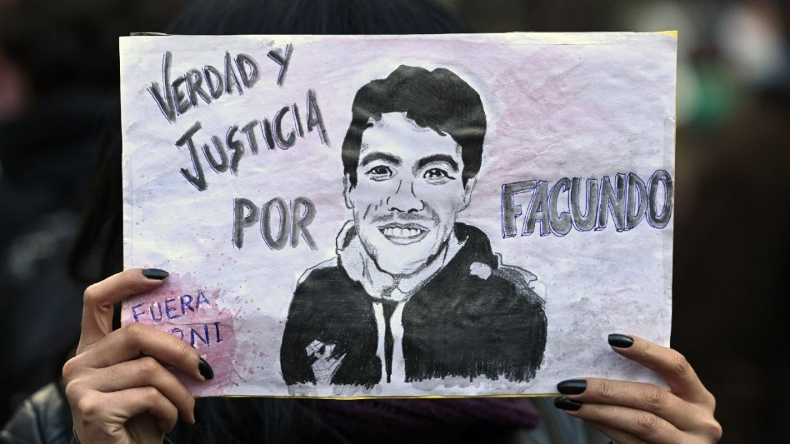 A woman displays a poster calling for justice for Facundo Castro, while marching to the Plaza de Mayo on Thursday.