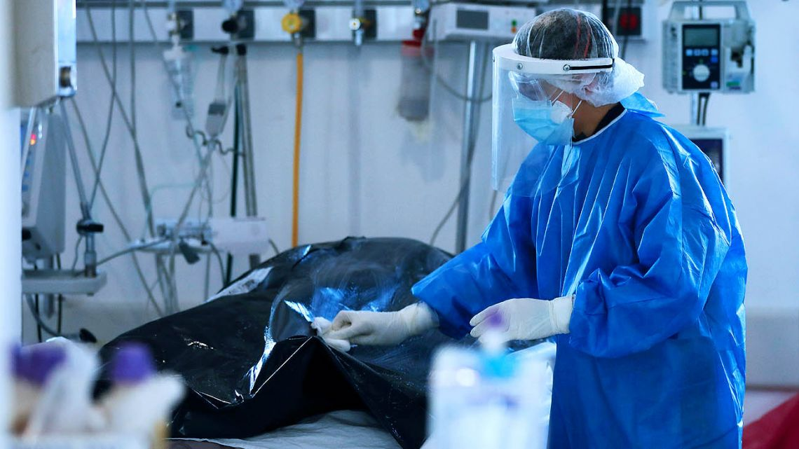 A health worker cleans the bodybag of a Covid-19 victim at a hospital in Buenos Aires City.