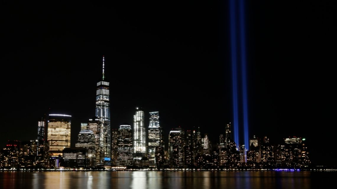 In this Septembber 11, 2017 photo, the Tribute in Light illuminates in the sky above the Lower Manhattan area of New York, as seen from across the Hudson River in Jersey City, New Jersey, US.