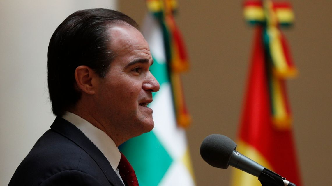 In this January 15, 2020 photo, the newly elected head of the Inter-American Development Bank, Mauricio Claver-Carone, speaks to the press after meeting with Bolivian Foreign Minister Karen Longaric in La Paz, Bolivia.
