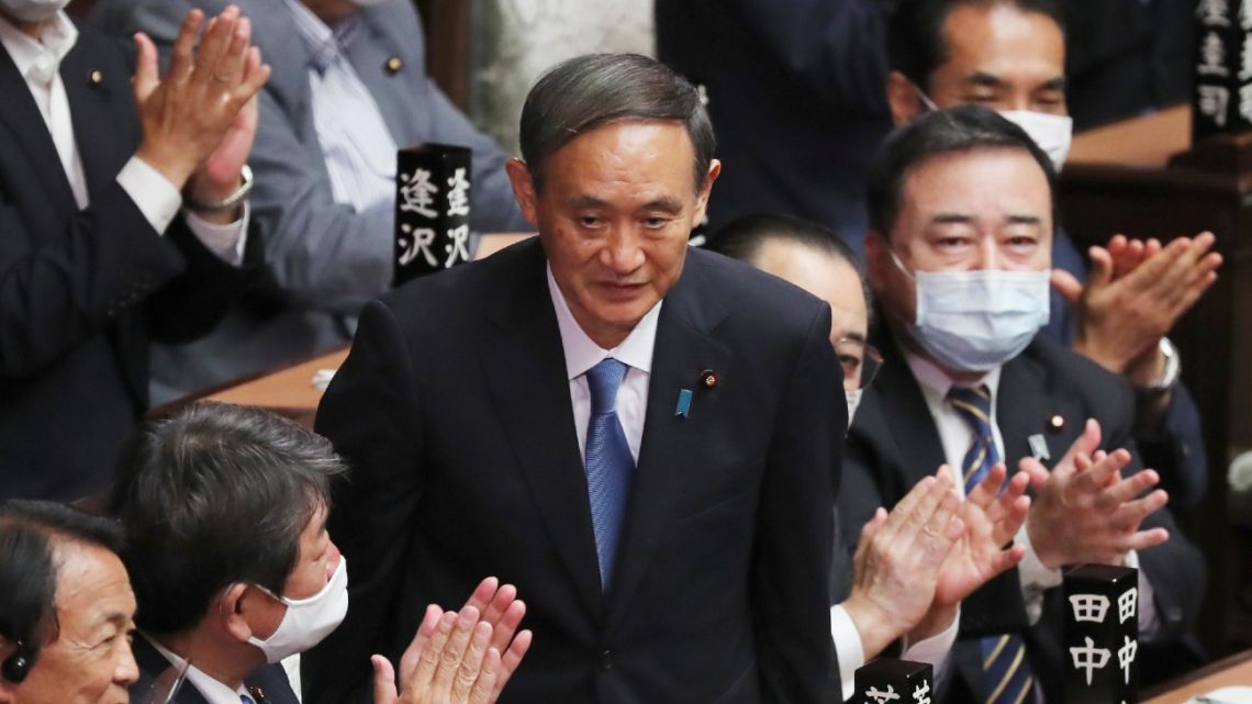 Yoshihide Suga is applauded after being elected as Japan's new prime minister at parliament's lower house in Tokyo, Wednesday, Sept. 16, 2020.