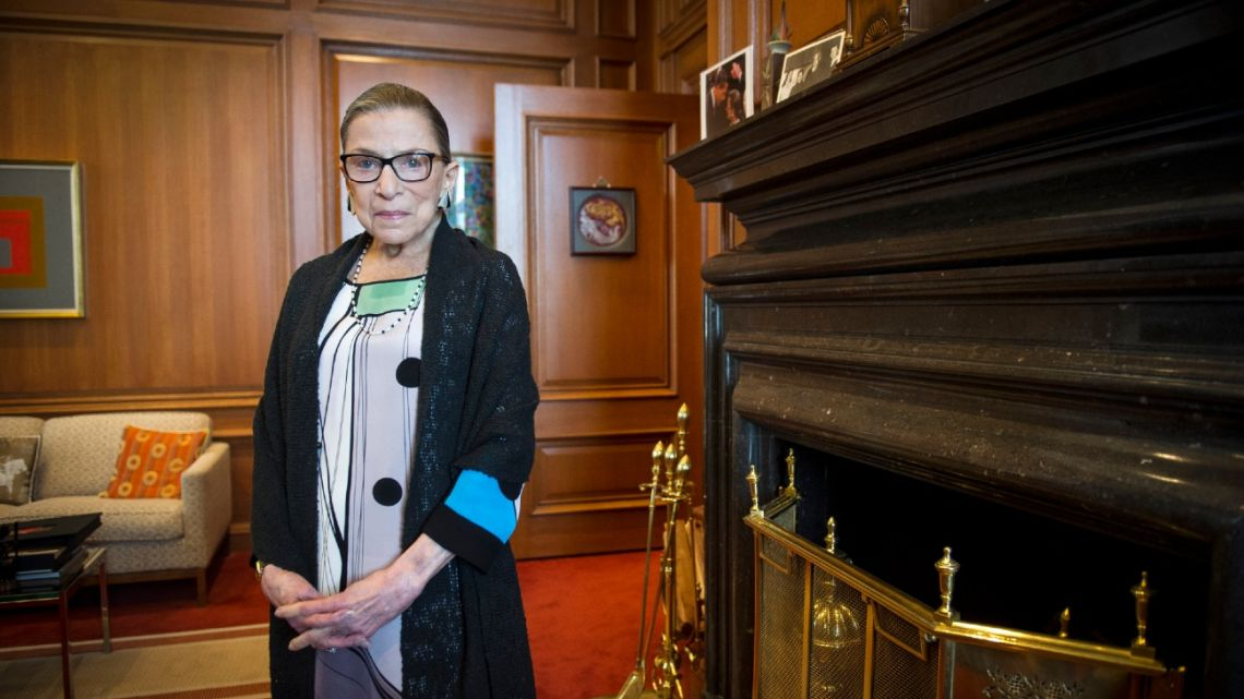 In this July 31, 2014, photo, Associate Justice Ruth Bader Ginsburg is seen in her chambers in at the Supreme Court in Washington.