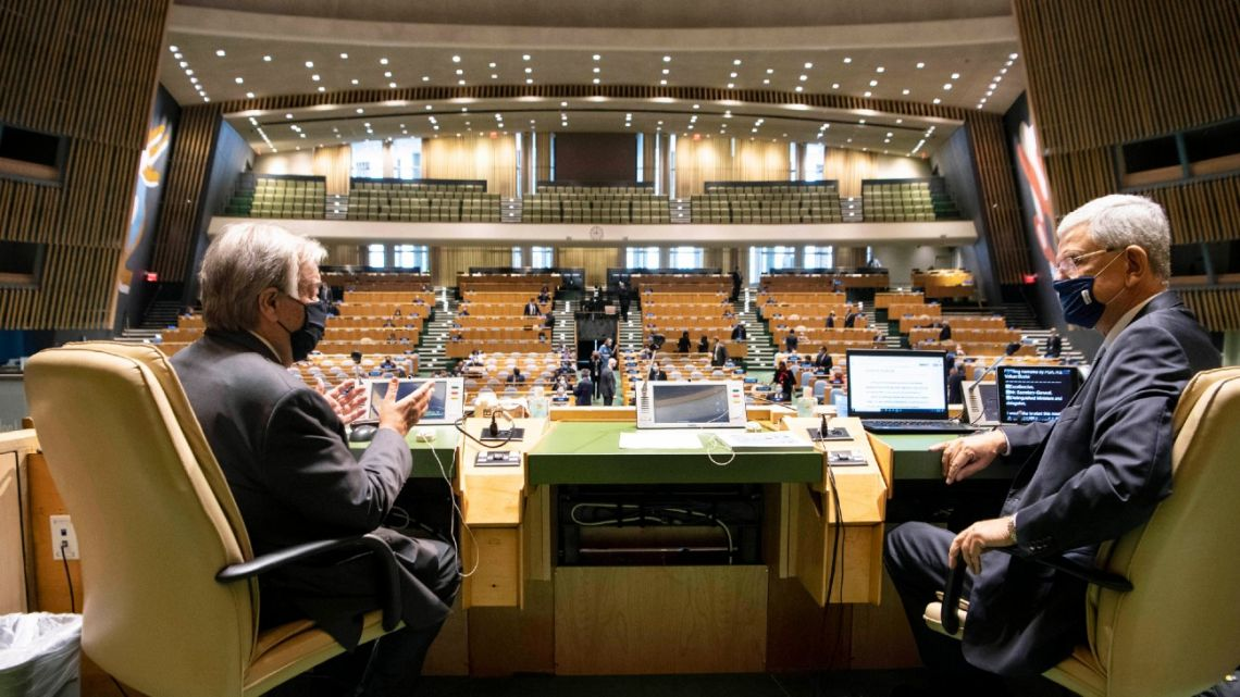 In this photo provided by the United Nations, United Nations Secretary-General António Guterres, left, and General Assembly President Volkan Bozkir, from Turkey, confer prior to the start of the General Assembly meeting commemorating the 75th anniversary of the United Nations, Monday, September 21, 2020.