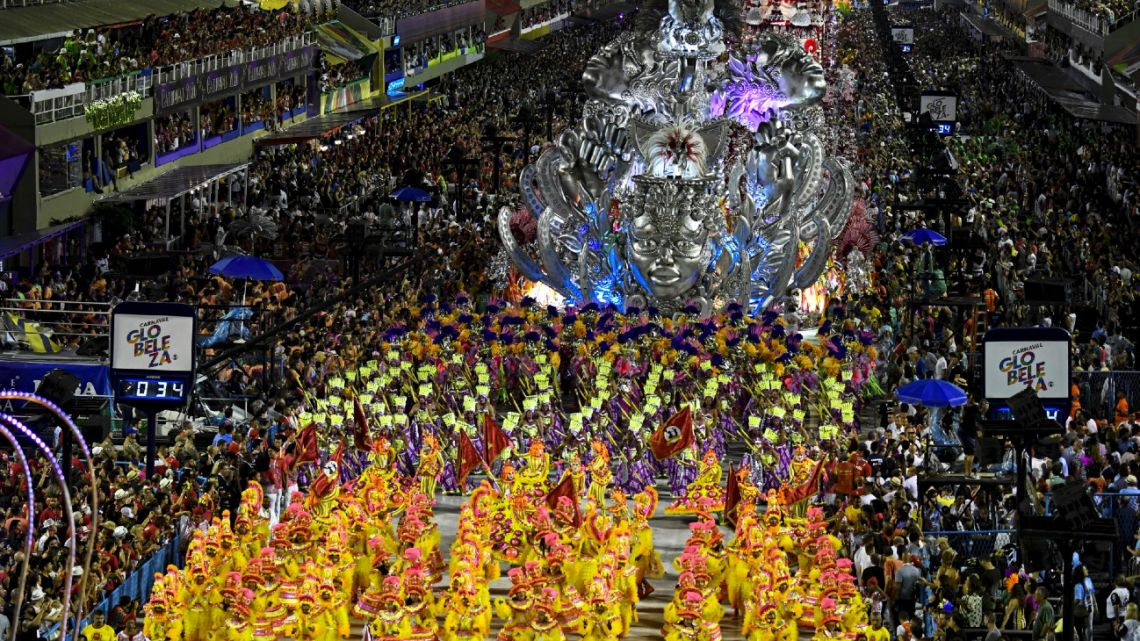 In this file photo taken on February 23, 2020, members of the Viradouro samba school perform during the first night of Rio's carnival parade at the Sambadrome in Rio de Janeiro, Brazil.