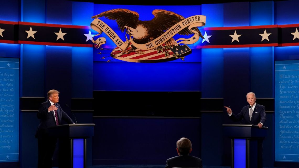 US President Donald Trump, left, and Democratic presidential candidate former Vice-President Joe Biden, right, with moderator Chris Wallace, centre, of Fox News during the first presidential debate Tuesday, September 29, 2020, at Case Western University and Cleveland Clinic, in Cleveland, Ohio.