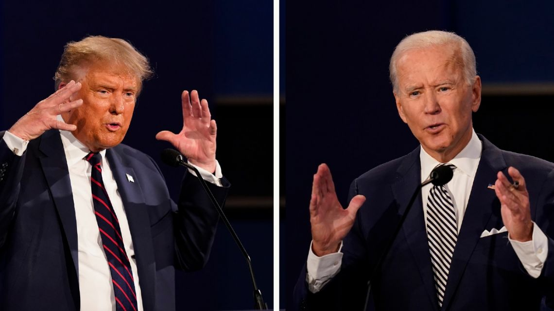 US President Donald Trump, left, and former Vice-President Joe Biden during the first presidential debate Tuesday, September 29, 2020, at Case Western University and Cleveland Clinic, in Cleveland, Ohio.