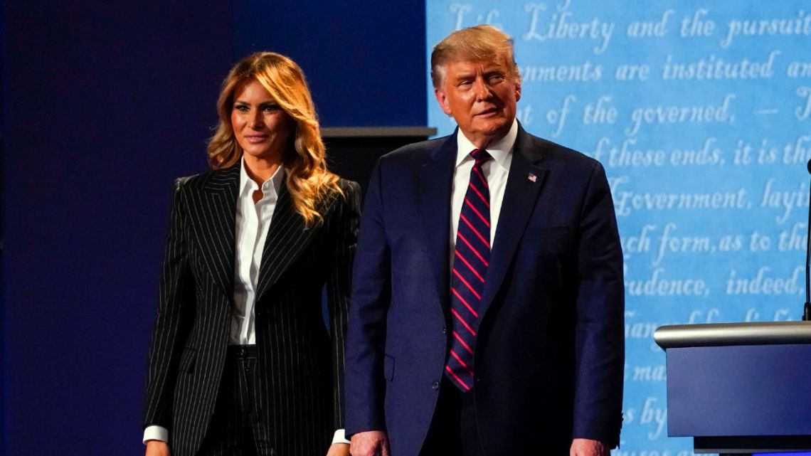 US President Donald Trump stands on stage with First Lady Melania Trump after the first presidential debate with Democratic presidential candidate former Vice President Joe Biden Tuesday, September 29, 2020, at Case Western University and Cleveland Clinic, in Cleveland, Ohio.