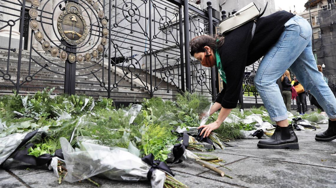 A woman puts some parsley on the stairs of Palace of Justice in Argentina.