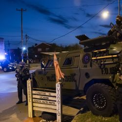 Members of the Federal Police stand guard at a checkpoint in 'La Granada,' a violent neighbourhood in Rosario on October 1, 2020.