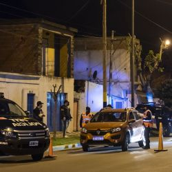 Members of the Federal Police inspect cars at a checkpoint in 'La Granada,' a violent neighbourhood in Rosario, Santa Fe Province.
