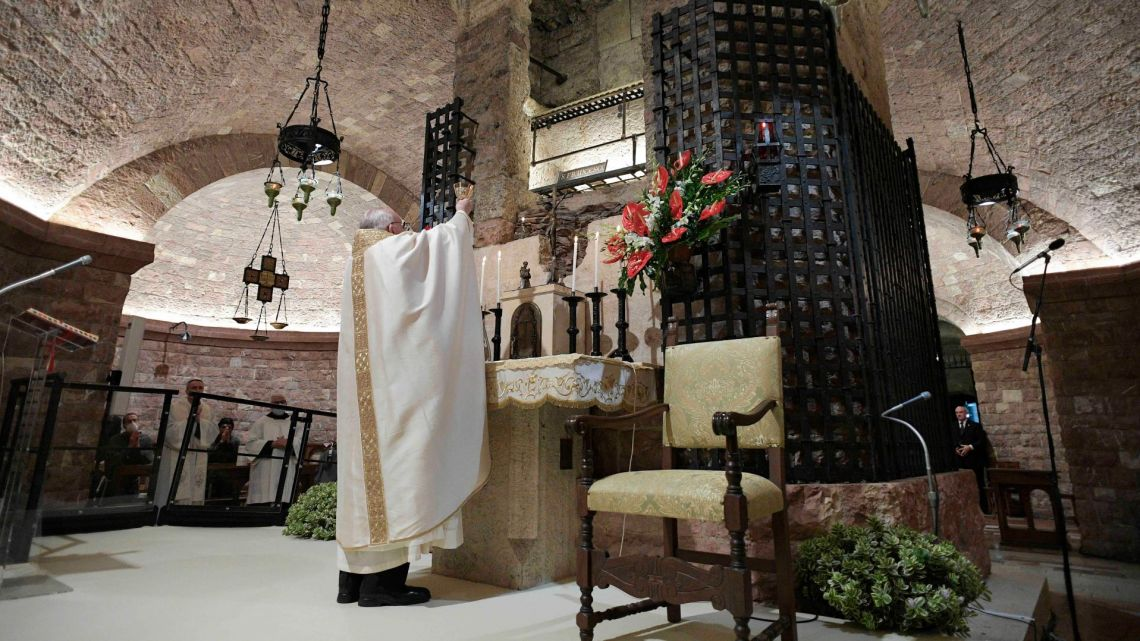 Pope Francis celebrates Mass in the crypt of the Basilica of St. Francis, in Assisi, Italy, Saturday, October 3, 2020.
