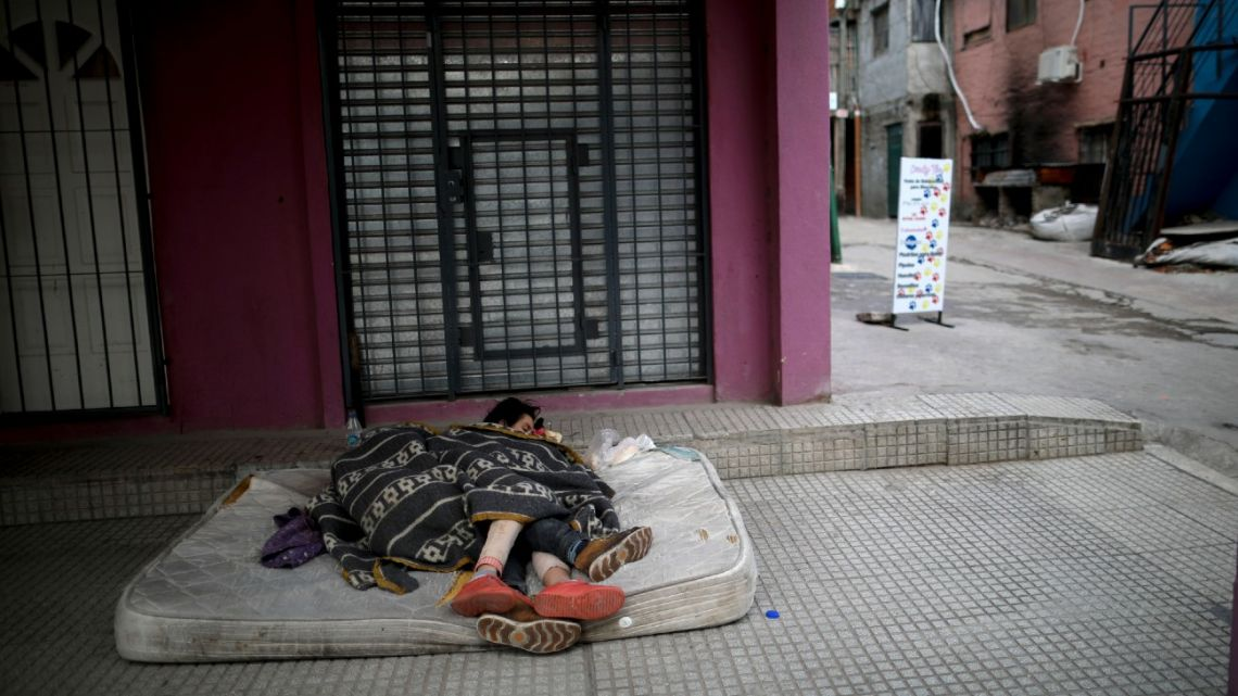 A homeless women sleep outside on a mattress in the City barrio of Villa 31, during the government-ordered lockdown to curb the spread of the new coronavirus in Argentina.