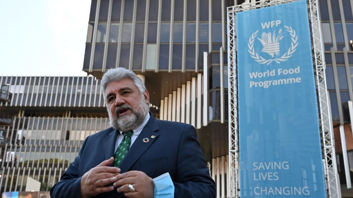 "Deputy Executive Director Amir Mahmoud Abdulla gestures as he speaks to media representatives outside The World Food Programme (WFP) headquarters in Rome on October 9, 2020, after the announcement that the organisation had been awarded the Nobel Peace Prize. World Food Programme chief David Beasley said that the UN agency was ""deeply humbled"" by winning the Nobel Peace Prize, adding it had rendered him ""speechless""."