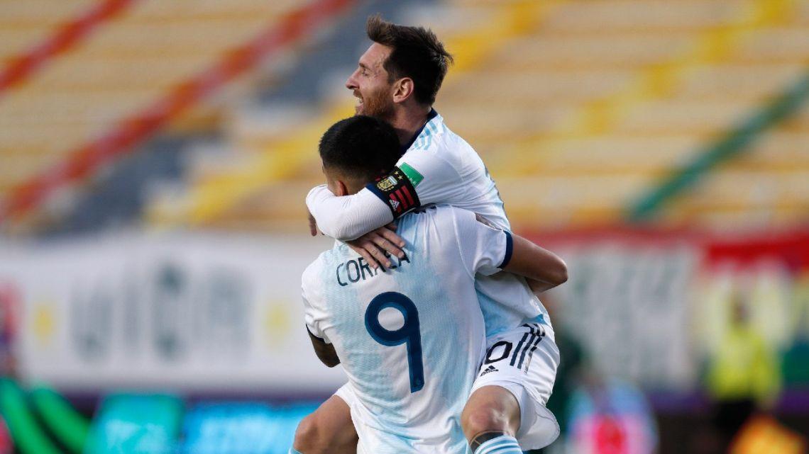Lionel Messi congratulates Joaquín Correa on his goal.