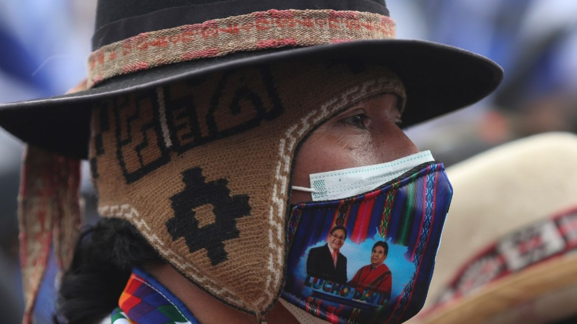 A supporter of Luis Arce, who is running for president for the Movement Towards Socialism party (MAS) attends the presidential campaign's closing campaign rally in El Alto, Bolivia, on Wednesday, October 14, 2020. Elections will be held October 18.