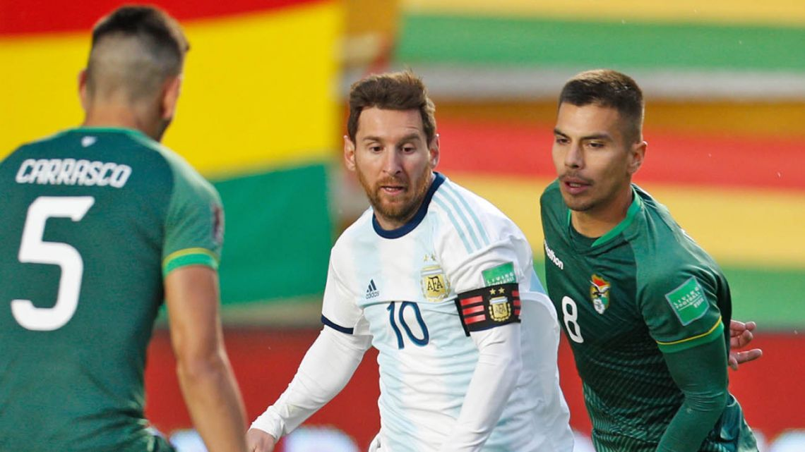 Lionel Messi takes on two Bolivia players during Argentina's 2022 FIFA World Cup South American qualifiing match this week.