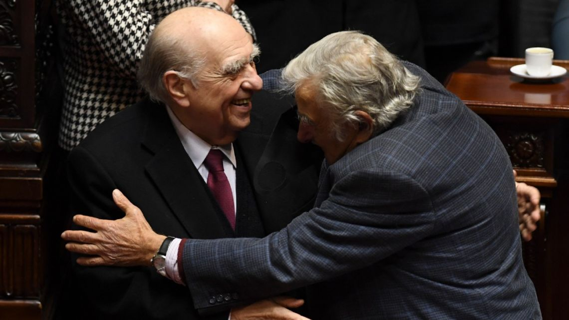 Uruguayan former presidents Julio Sanguinetti (left) (1985-1990, 1995-2000) and José Mujica (2010–2015) embrace during their last session as senators, at the Congress in Montevideo on October 20, 2020.