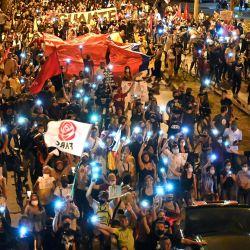 La gente marcha durante un paro nacional contra el gobierno del presidente colombiano Iván Duque, en Cali, Colombia. | Foto:Luis Robayo / AFP