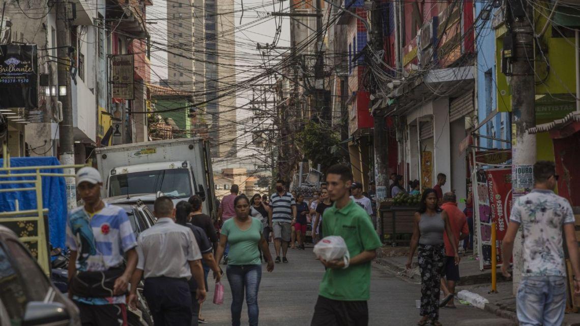 Pedestrians walk through the Paraisopolis favela of São Paulo, Brazil, on April, 23.