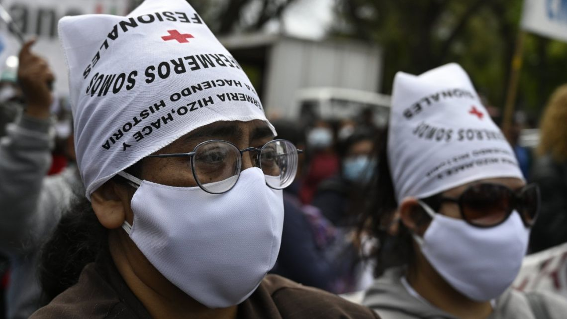 Nurses take part in a demonstration requesting better working conditions in front of the City government headquarters in Buenos Aires, on October 21, 2020 amid the COVID-19 coronavirus pandemic.