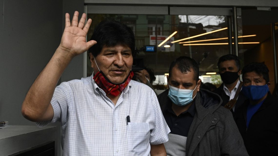 Former Bolivian President Evo Morales waves while leaving following a press conference in Buenos Aires.