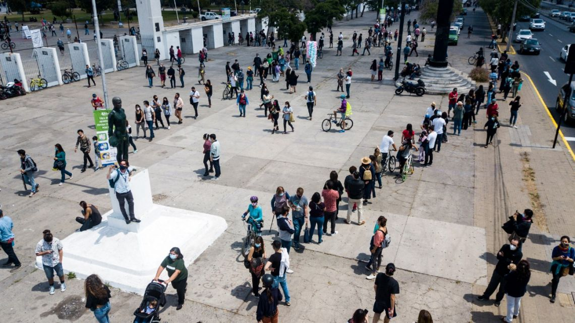 In this aerial view people queue to cast their ballot in a constitutional referendum voting at a polling station in the National Stadium of Santiago, on October 25, 2020.