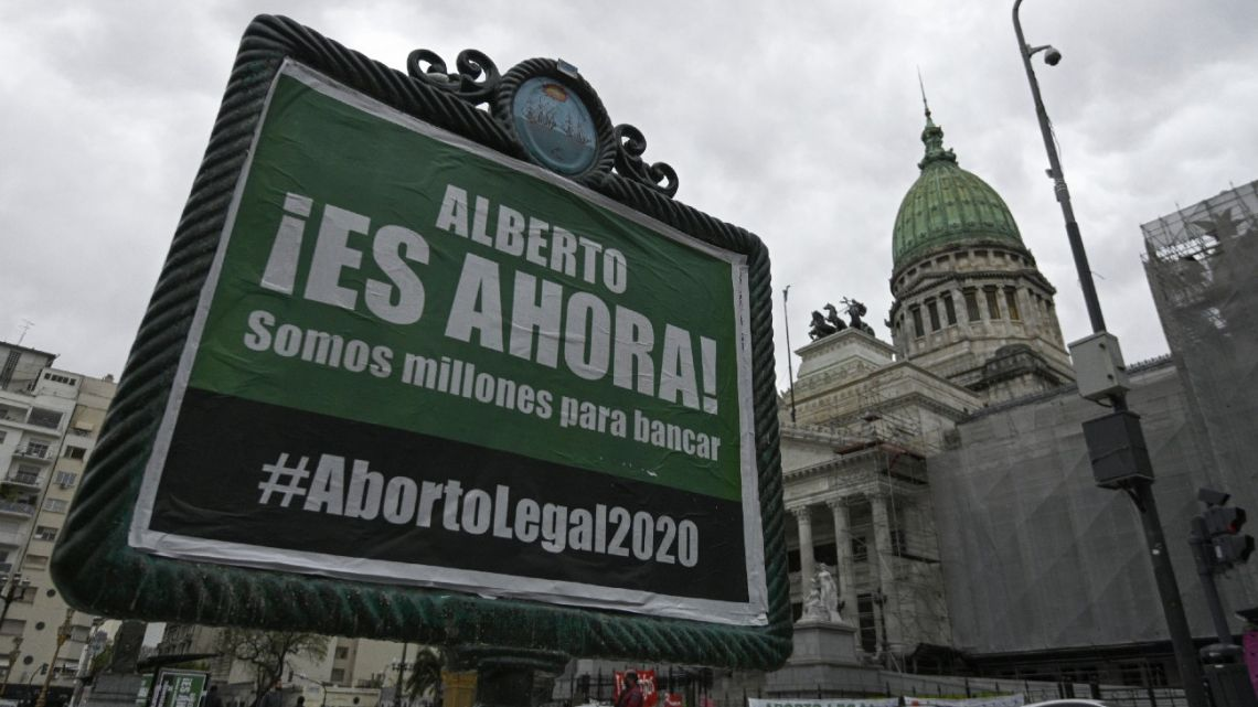 An advertising poster asks President Alberto Fernández to present a new bill to legalise abortion is pictured outside Congress in Buenos Aires.