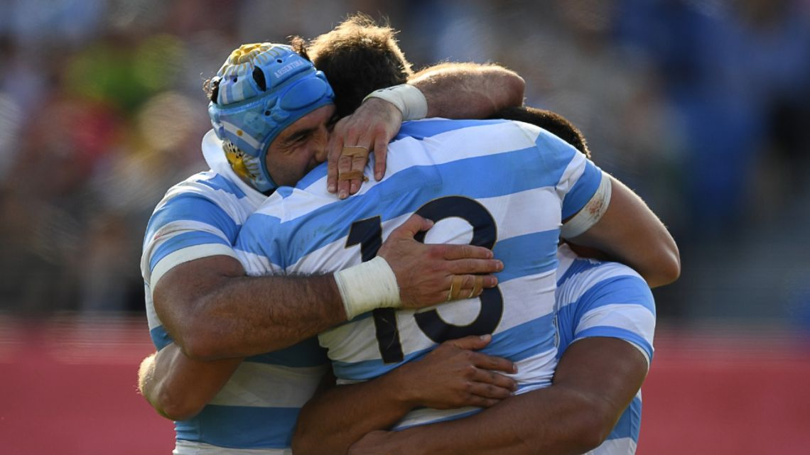 Argentina's players celebrate a try during the Japan 2019 Rugby World Cup Pool C match between Argentina and the United States at the Kumagaya Rugby Stadium in Kumagaya.