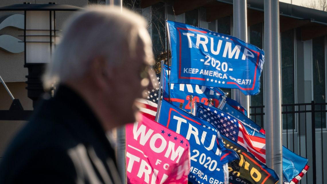 Supporters of Donald Trump rally outside the gates of the venue as Democratic presidential nominee Joe Biden speaks during a drive-in campaign rally at the Minnesota State Fairgrounds on October 30, 2020 in St. Paul, Minnesota.