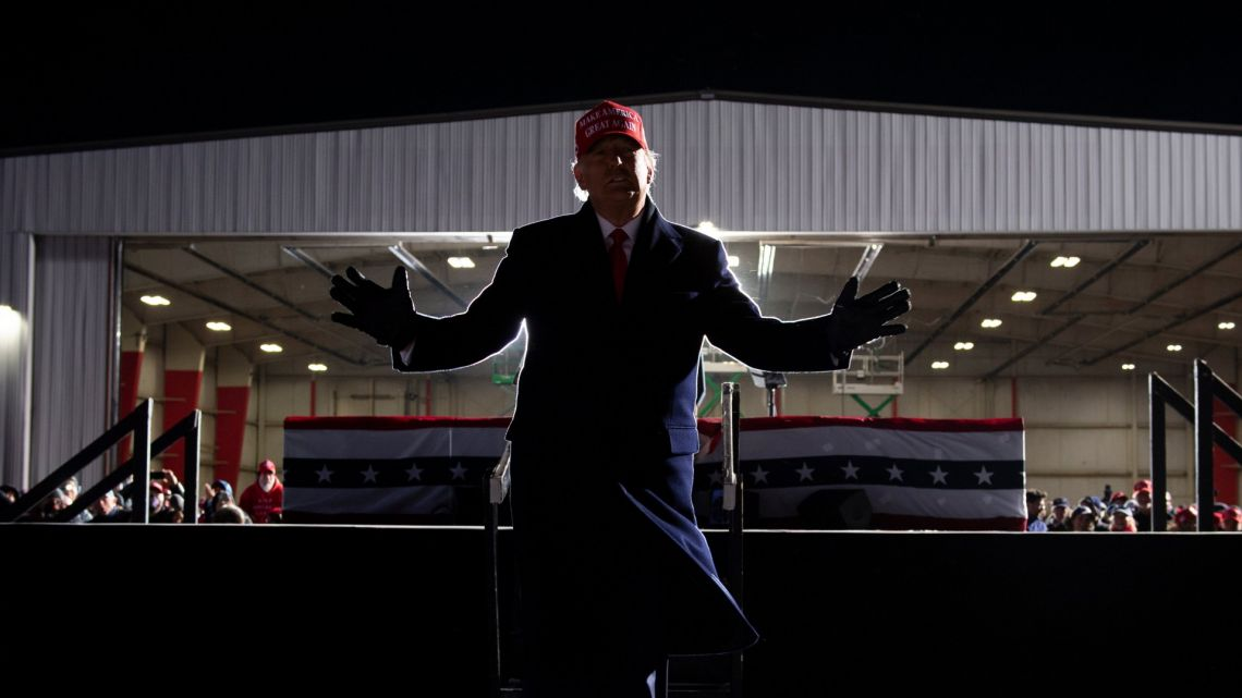 US President Donald Trump leaves after speaking during a Make America Great Again rally at Cherry Capital Airport November 2, 2020, in Traverse City, Michigan.