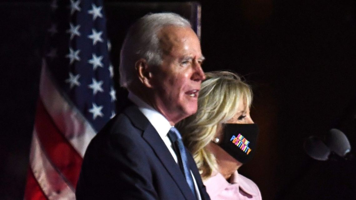 Democratic presidential nominee Joe Biden (left) stands with wife Jill Biden as he addresses supporters during election night at the Chase Center in Wilmington, Delaware, early on November 4, 2020.