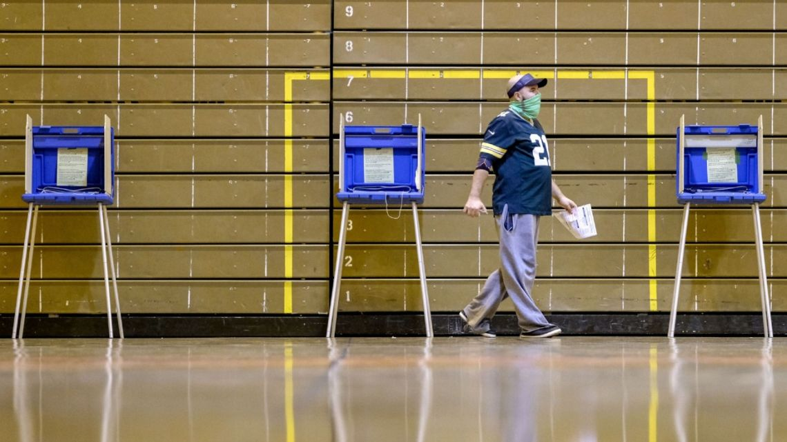 A voter casts a ballot in the US election on Tuesday.