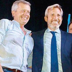 Emilio Monzó y Rogelio Frigerio. | Foto:Cedoc.