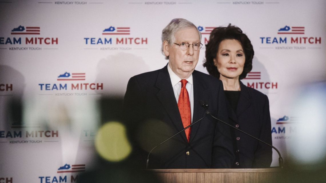 Senate Majority Leader Mitch McConnell, a Republican from Kentucky, speaks as wife Elaine Chao, US secretary of transportation, right, listens during an election night party in Louisville, Kentucky, United States, on Tuesday, November 3, 2020.
