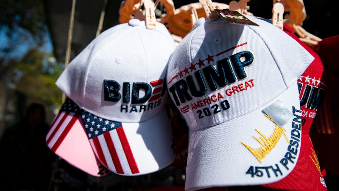 Hats for sale supporting Democratic presidential nominee Joe Biden and US President Donald Trump hang for sale near the White House, on November 5, 2020 in Washington, DC.
