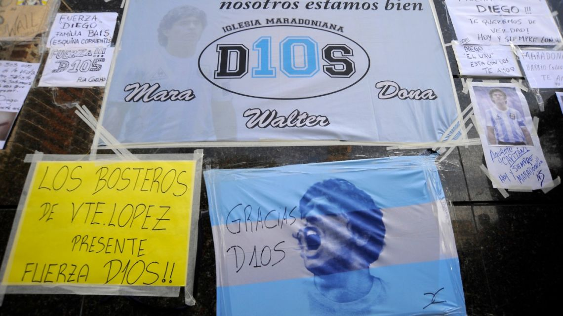 View of messages and flags placed by supporters of Diego Maradona, outside the private clinic where Maradona underwent a brain surgery for a blood clot, in Olivos, Buenos Aires Province, on November 4, 2020.