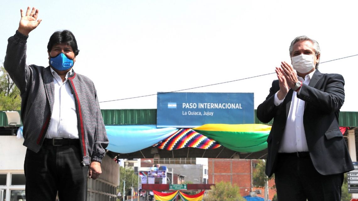 Picture released by government shows Bolivia's former president Evo Morales (left) waving  next to President Alberto Fernández in La Quiaca, Argentina, before crossing on foot back to his country in Villazón, southern Bolivia, on November 9, 2020.