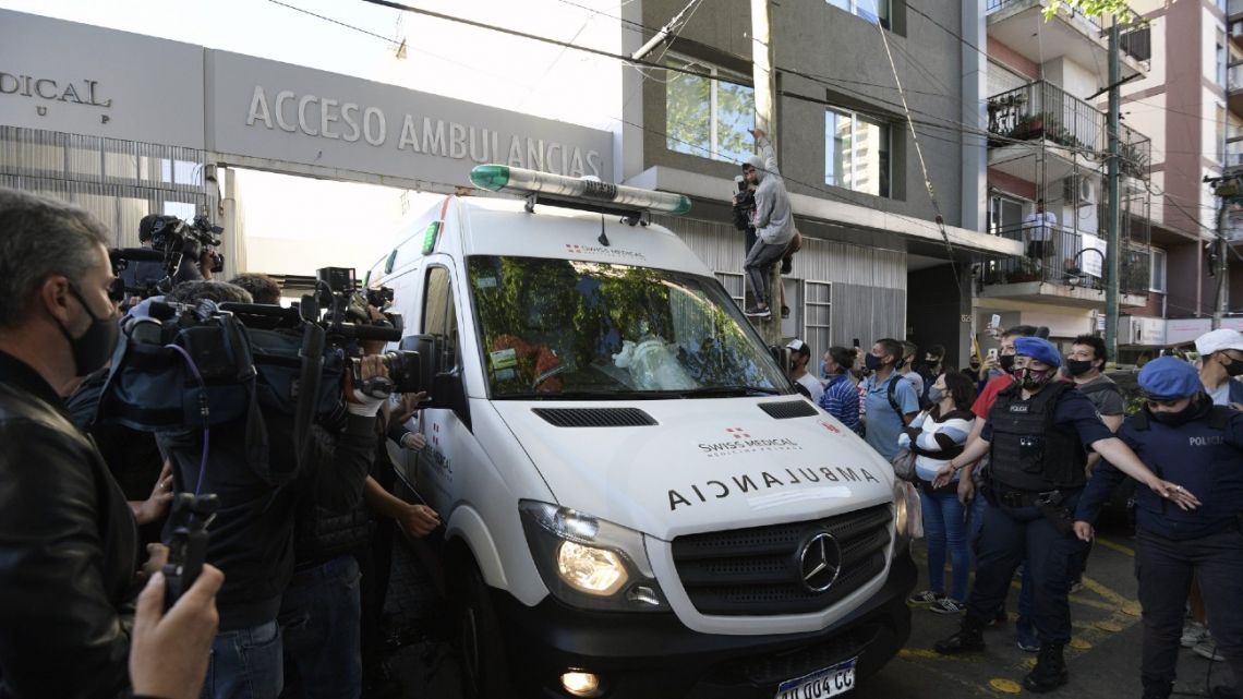 An ambulance carrying Argentine former football star and coach of Gimnasia y Esgrima La Plata Diego Maradona, leaves the clinic where he underwent brain surgery for a blood clot, in Olivos, Buenos Aires province, on November 11, 2020.