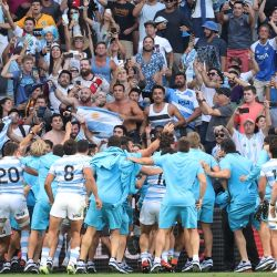Argentina's players celebrate victory with their fans at the end of 2020 Tri-Nations rugby match between New Zealand and the Pumas at Bankwest Stadium in Sydney on November 14, 2020.