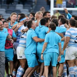 Argentina's players celebrate victory at the end of 2020 Tri-Nations rugby match between New Zealand and the Pumas at Bankwest Stadium in Sydney on November 14, 2020.